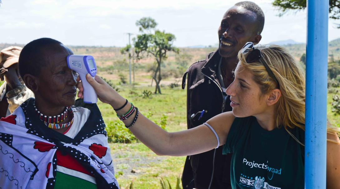 A Projects Abroad medical volunteer helps doctors and nurses with different medical tasks during a medical outreach in Kenya.